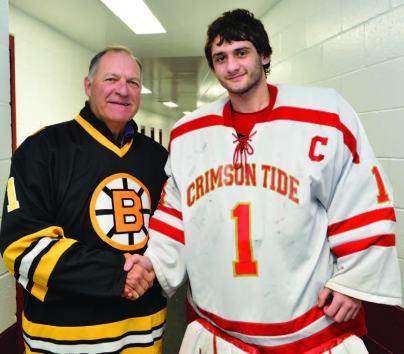 Former Bruins goaltender Reggie Lemelin is pictured with Everett High School senior Brendan Calderon