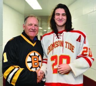 Former Bruins goaltender Reggie Lemelin is pictured with Everett High School senior Kevin O'Brien