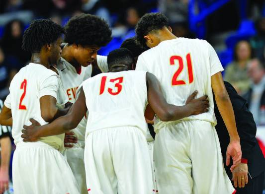 Isaiah Likely, Ghared Boyce (2), Nate Mehu (13), and Erick Thompson (21) huddle up during a timeout.