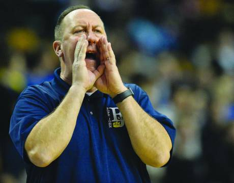 Pope John coach Leo Boucher shouts instructions to the Tigers during the Div. 4 State Semifinal win over Mashpee Monday in TD Garden.