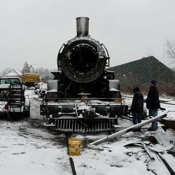 November 2008: Workers in the Knox and Kane Railroad yard at Kane, PA disassemble #38.  The cab and boiler will be shipped to Maryland, and the tender and running gear shipped to Claysburg.    Alan W. Maples, photograph