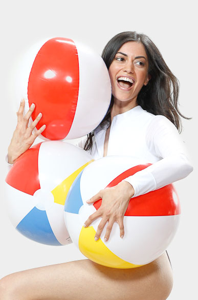Brunette woman beach ball outtake