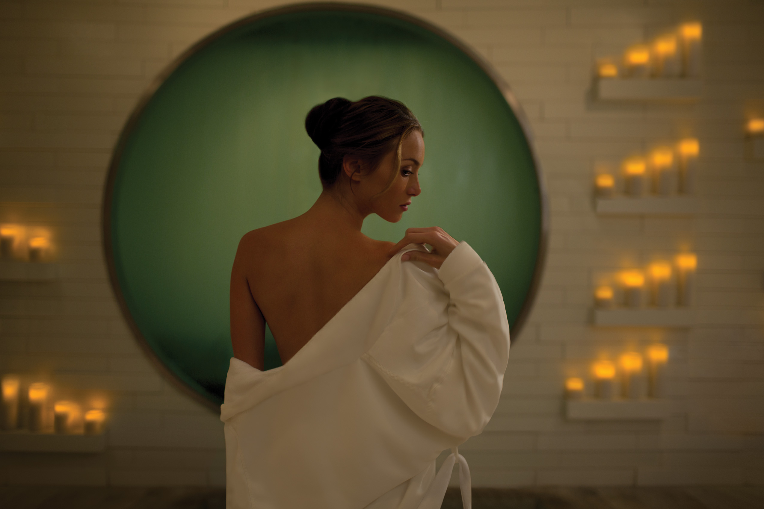Woman in spa with candles