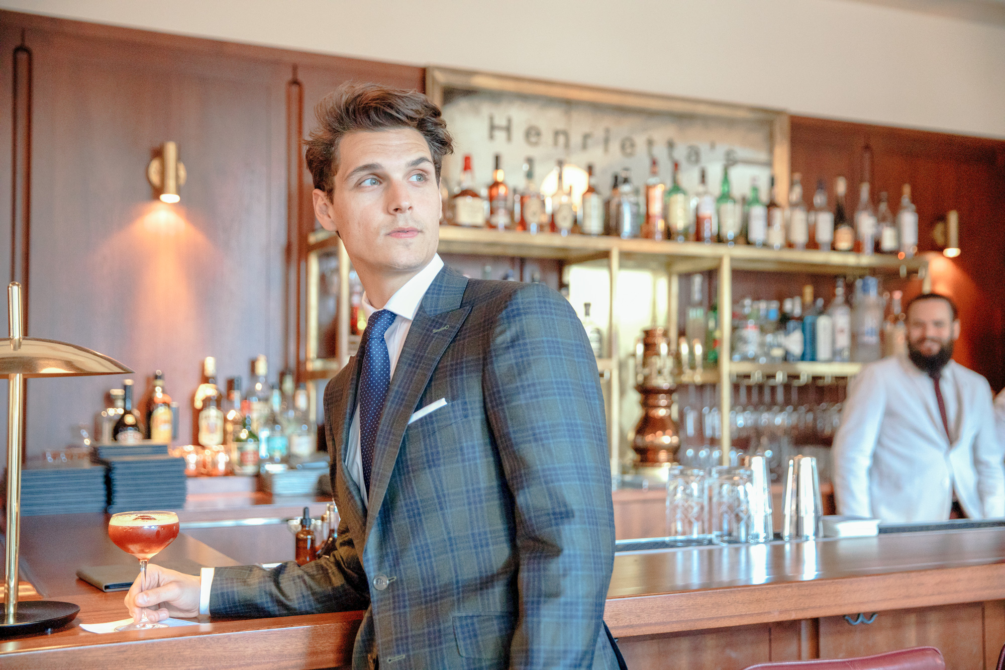 Man in suit at bar