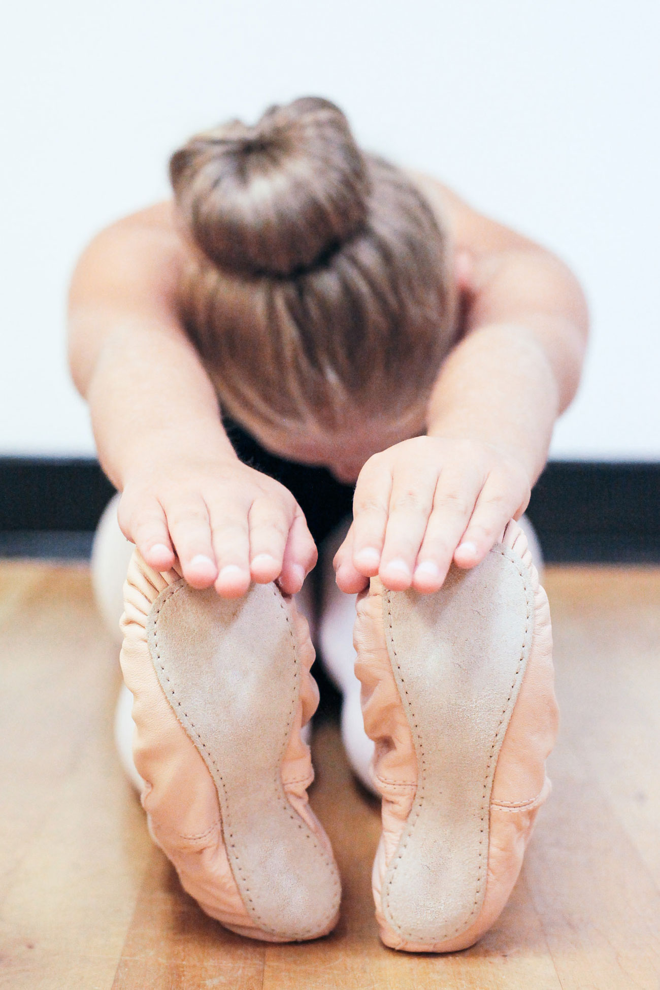 Ballerina touching toes