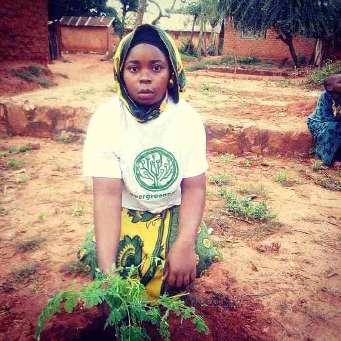 Tanzania girl planting