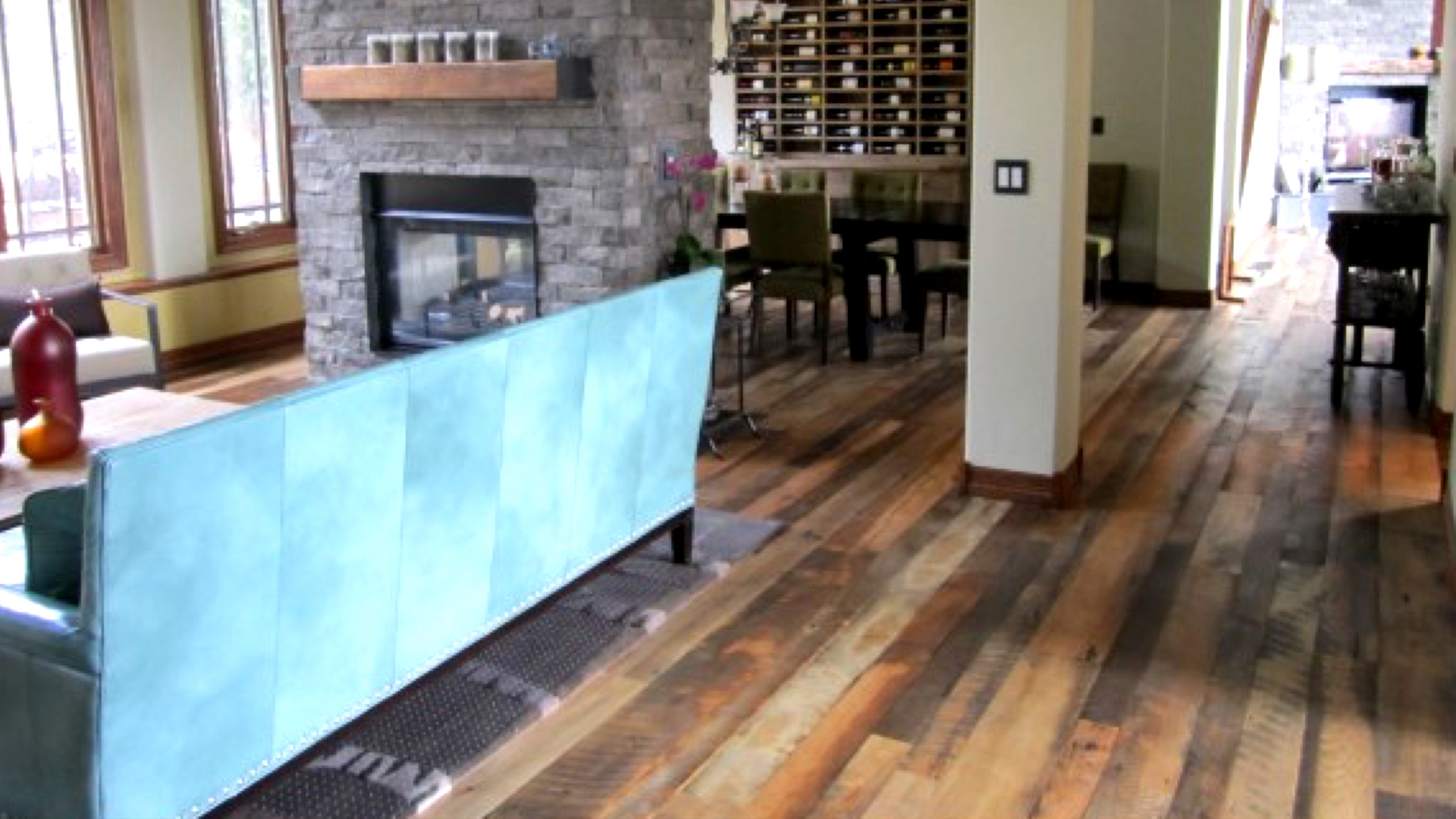 Hardwood Flooring with couch and fireplace