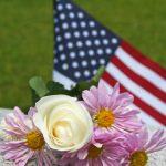 flower and flag on monument base