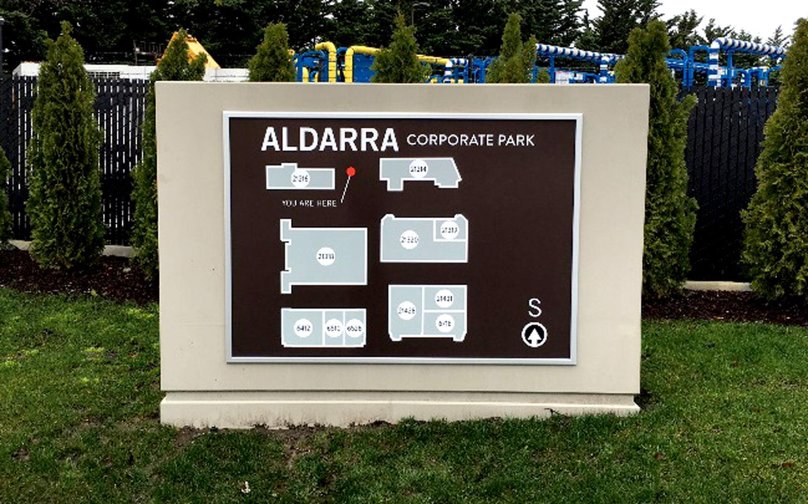 Evergreen permitted and fabricated two directional monument signs for Aldarra Corporate Park.