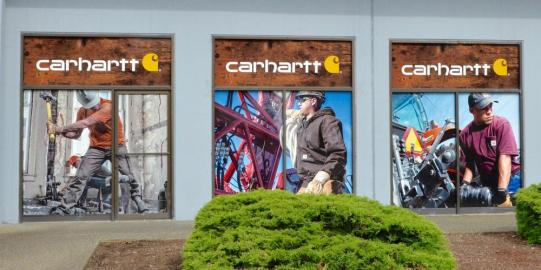Carhartt is a recognized brand. And building security makes full coverage a great option if you have street level full length windows and doors to obscure and foot traffic to consider.