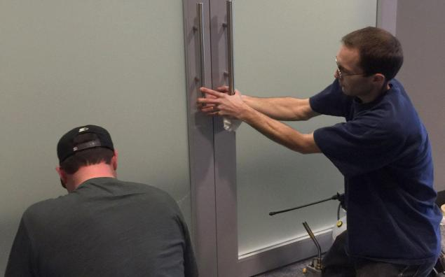 Sometimes it takes two sets of hands to make sure frosted door panels are installed without a hitch.