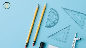 Mathematical methods equipment, pencils and protractors against a blue background.