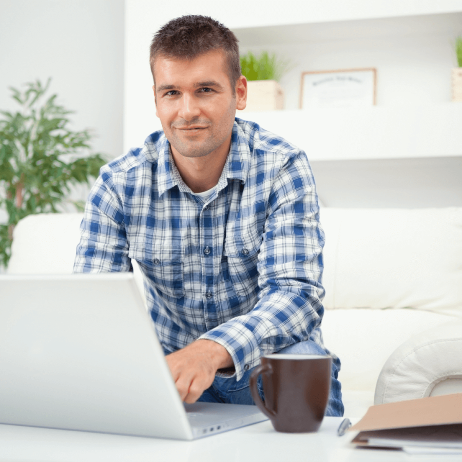 Happy adult male having an online tutoring lesson