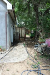 Life Unfiltered - The hot mess that is the back of the house - hoses, crushed mulberries, unplanted lemongrass