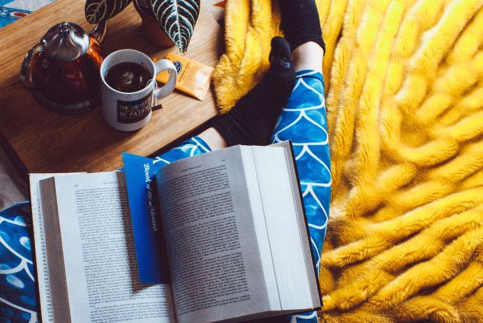 reading book blue leggings tea relaxing
