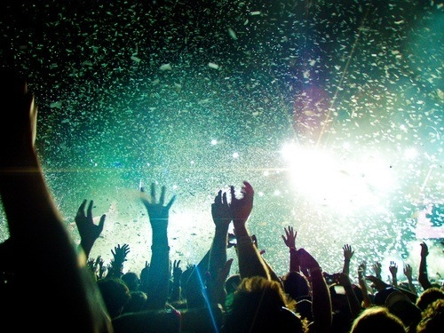 party concert fans lighting confetti teens music