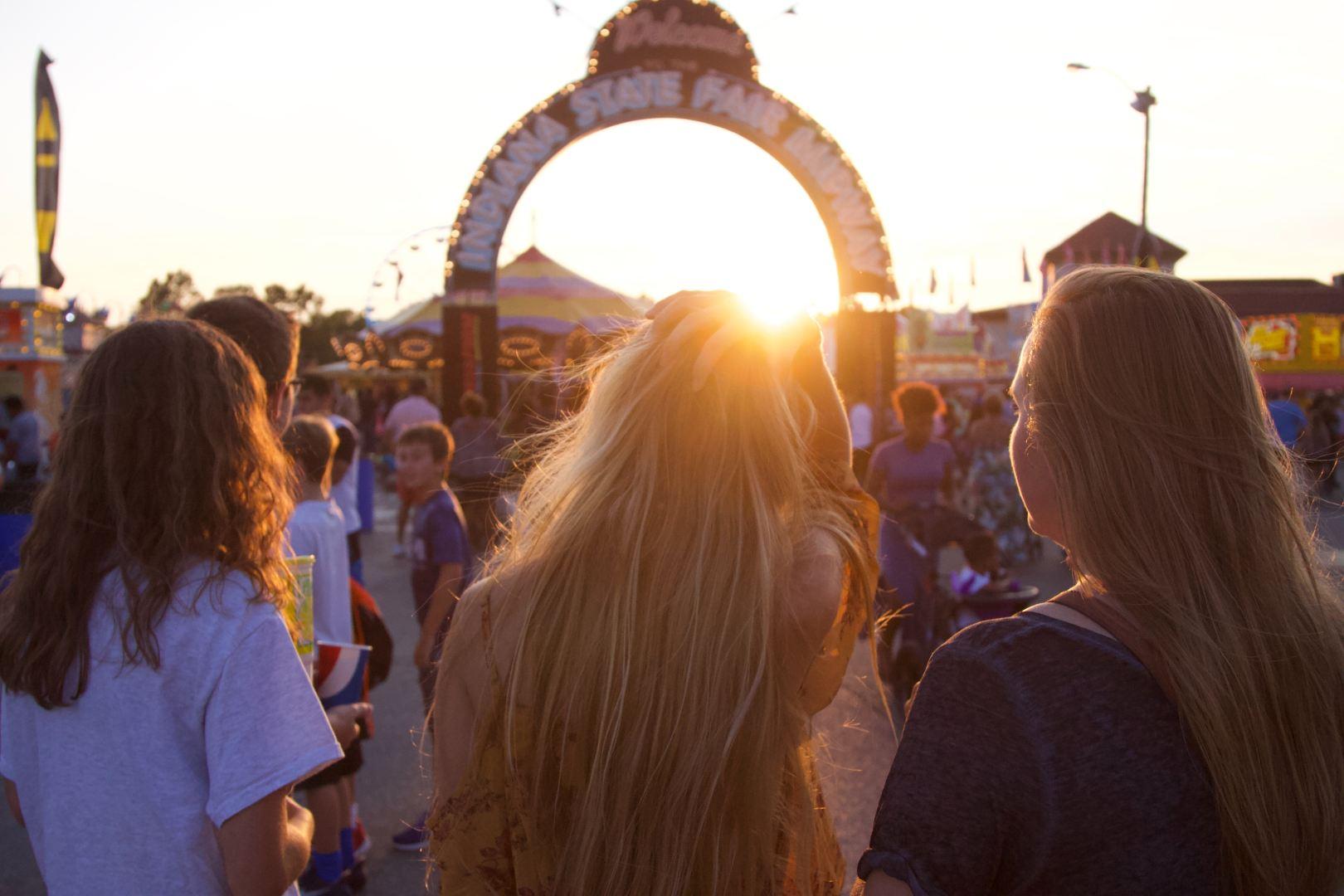 girls summer fair carnival sunset sun