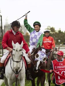 Female jockey celebrating her win