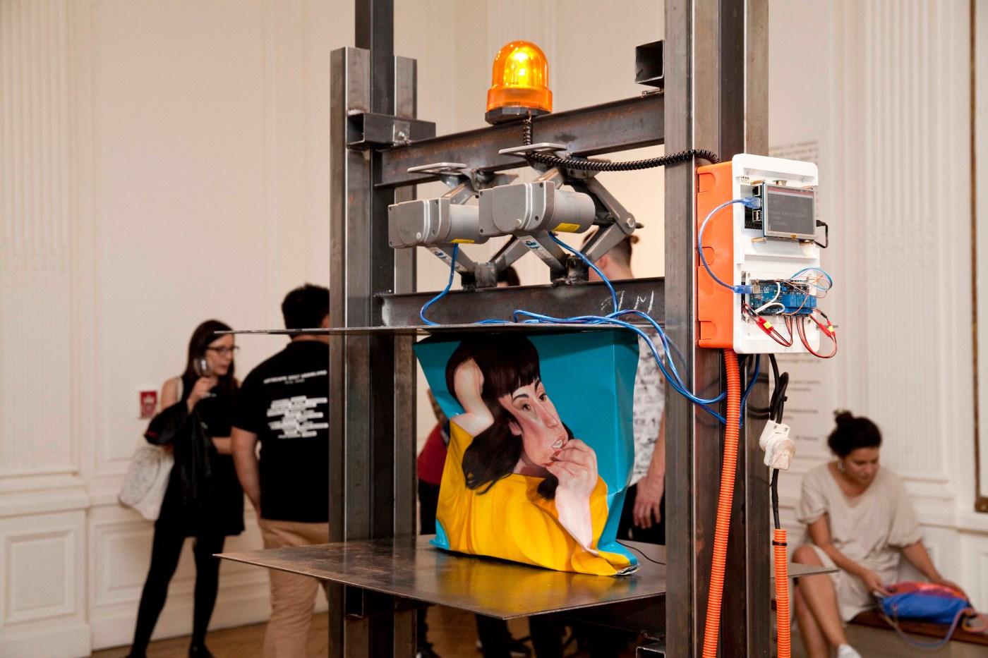 Machine destroying a piece of art