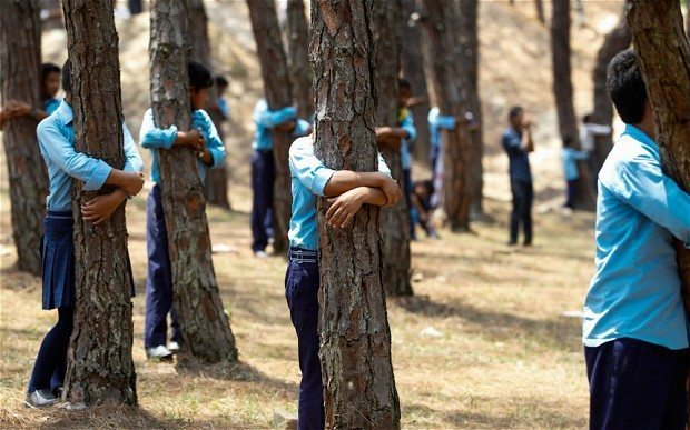Image: Students hugging trees in Nepal