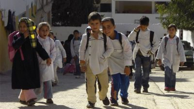 Image: Young kids in a city street in the middle-east