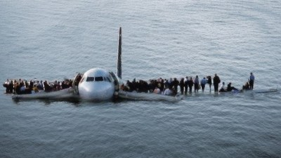Image: Passengers exit Hudson River plane crash