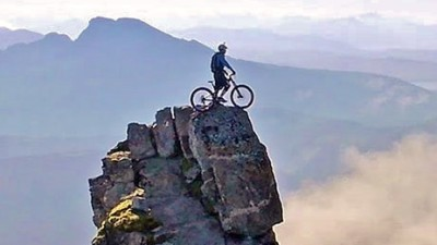 Image: Danny Macaskill on bicycle on top of cliff