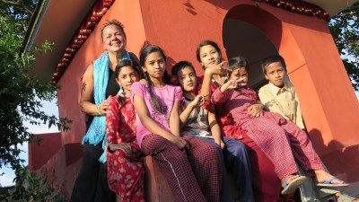 Image: Dr. Lynda and a group of Nepali Children