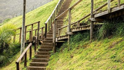 Image: Set of stairs going 4 ways on a beautiful grassy hill