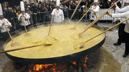 Image: 8 Chefs making a HUGE omelette in front of a big crowd