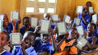 Image: Kids with tablets in a classroom