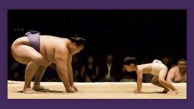 Image: Sumo wrestler and child stare each other down