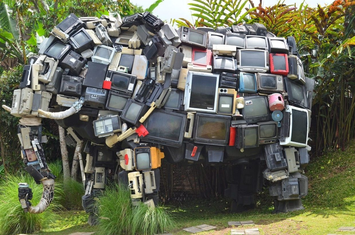 Image: A life-sized elephant sculpture made entirely of TVs