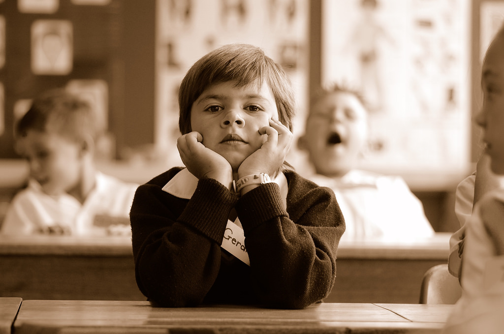 Image: A boy bored at school