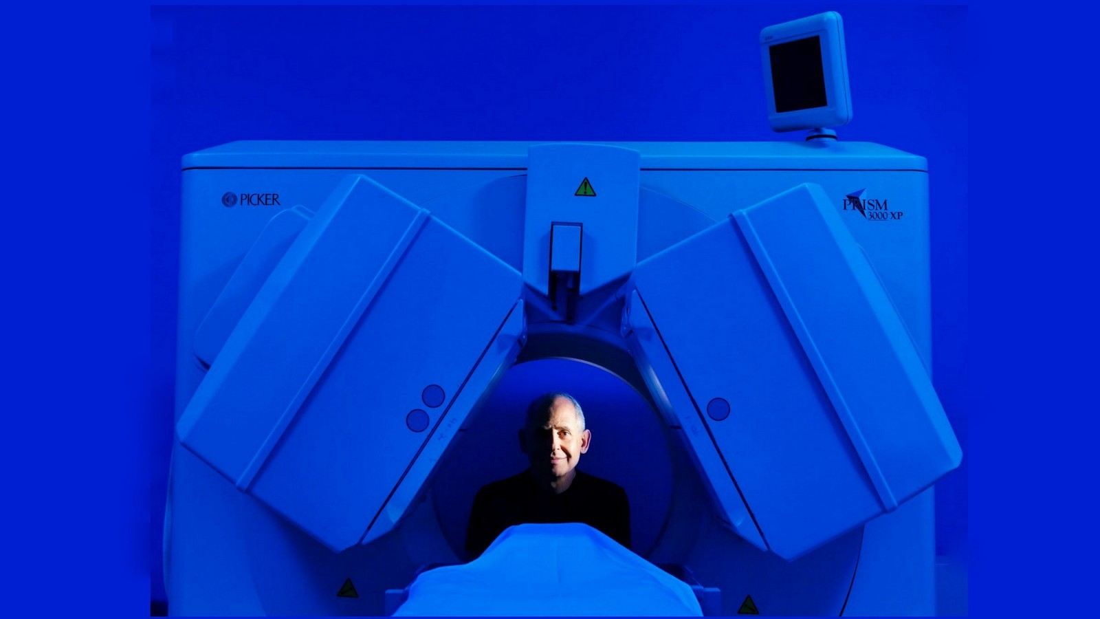 Image: Dr. Amen in the SPECT scan machine
