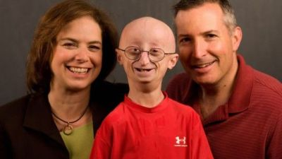 Image: Sam Berns and his parents with Sam's Happiness Secrets