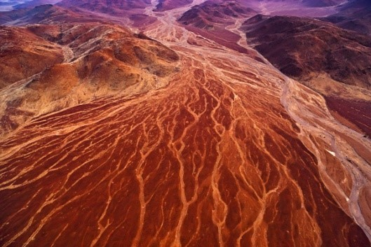 Image: Aerial view of orange desert from above