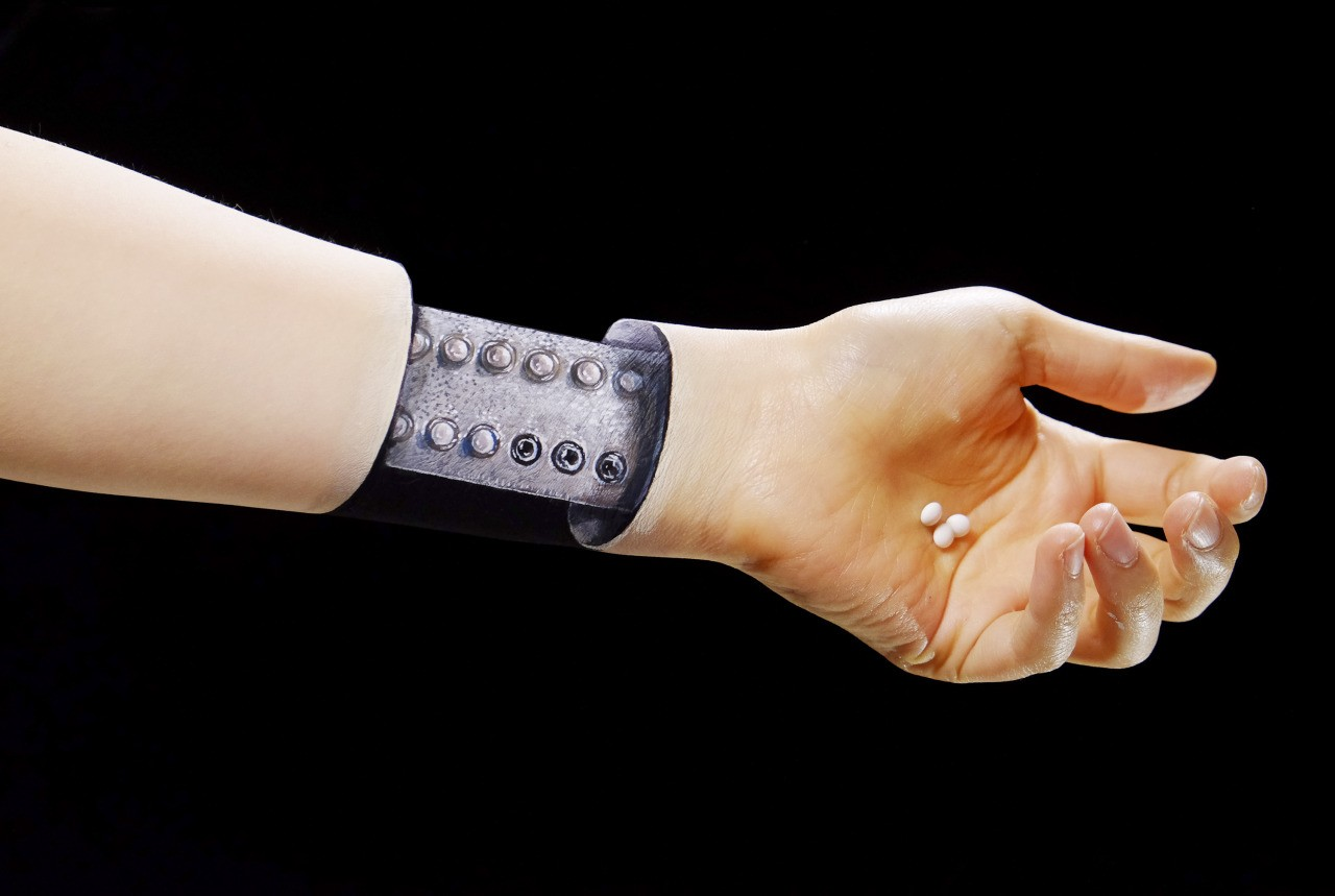 Image: Arm looks to be come apart revealing birth control pills by Hikaru Cho