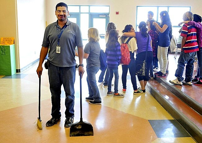 Image: Janitor with kids in a school