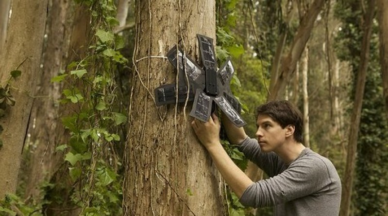Topher White installing Rainforest Connection an invention that is saving the rainforest with old cell phones