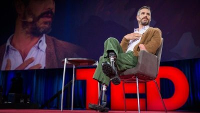 Image: Dr. Miller on the stage with his prosthetic legs