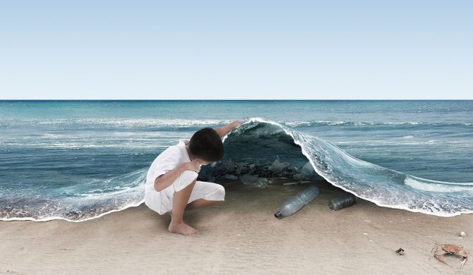 Image: A child pulls back the water on a beach revealing all the plastic garbage