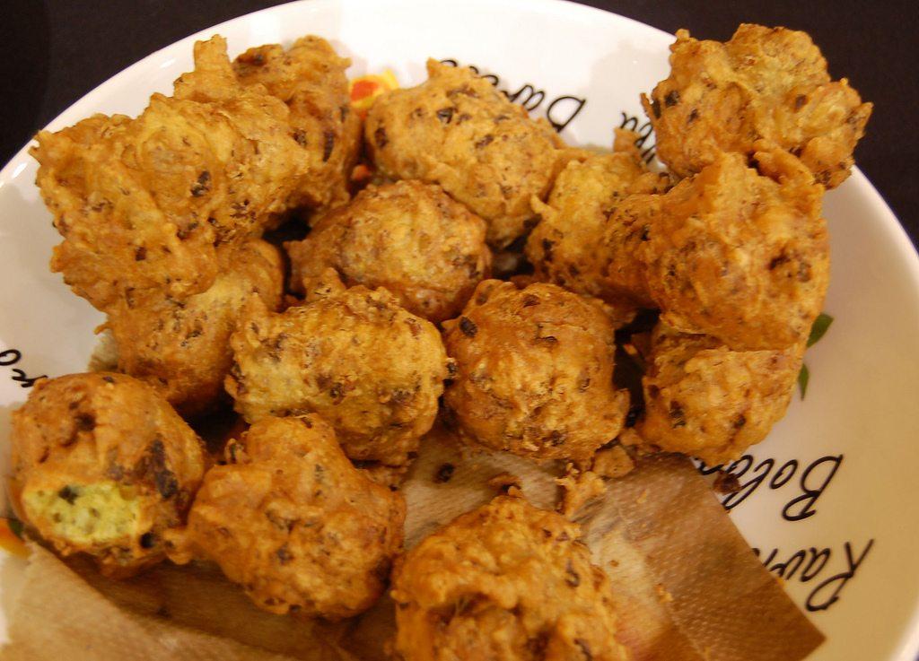 Image: Crispy dark brown balls of dough with clam chunks