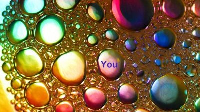 Image: Bubbles of multicolors with the word YOU in one