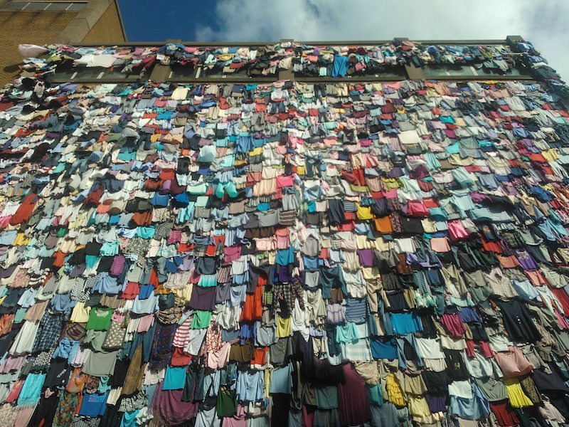 Image: Wall of Clothing telling us to buy clothing smarter
