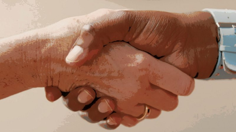 Image: two people shaking hands