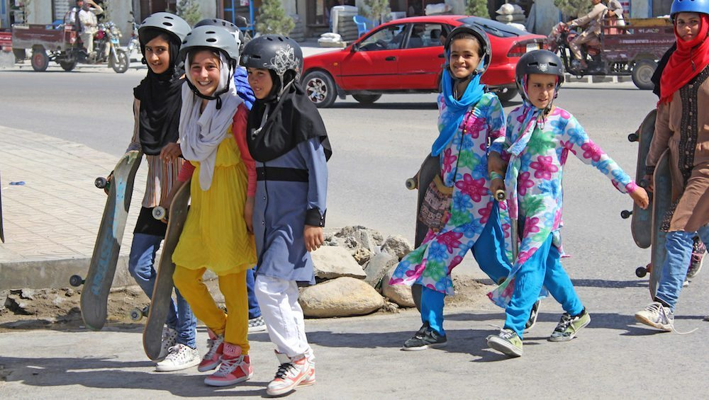 Image: Afghan girls walking with skateboards