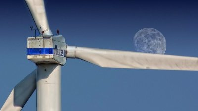 Image: Wind turbine blade with the moon rising on it