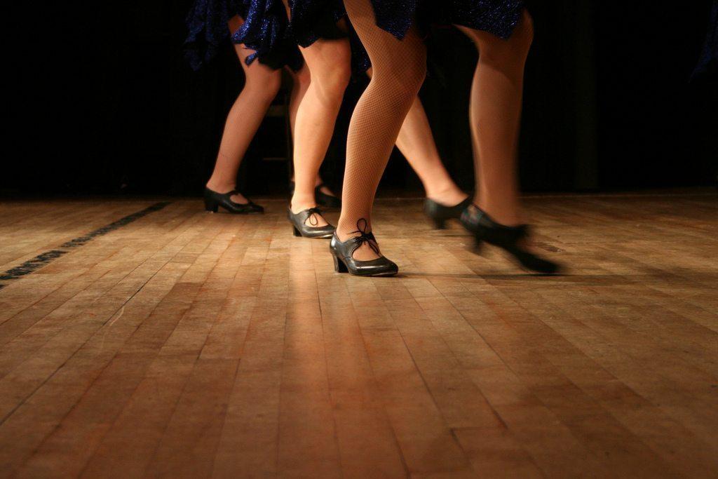 Image: Tap dancers on a wooden floor