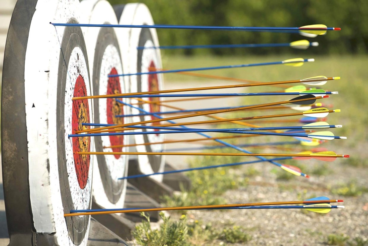 Image: a row of targets with arrows in them